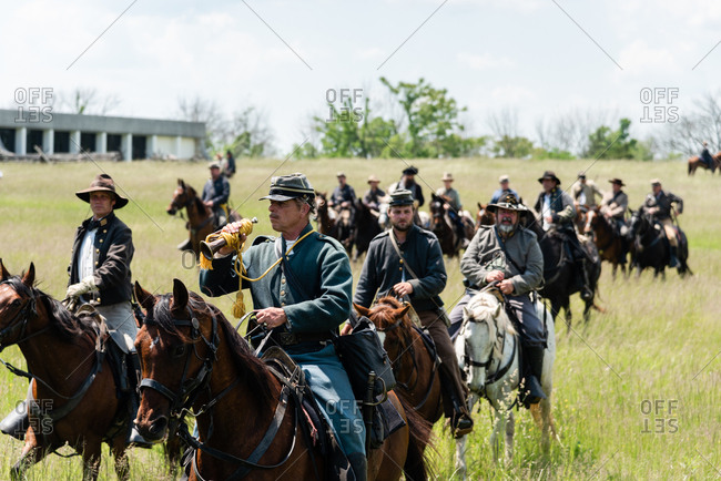 Virginia, USA - May 18, 2019: Cavalry on horses firing guns during Civil War Reenactment