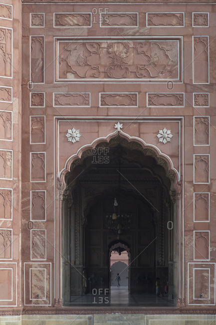 Lahore, Pakistan - April 29, 2018: Arch at the Badshahi Mosque, the grandest of Pakistan's Mughal-era mosques