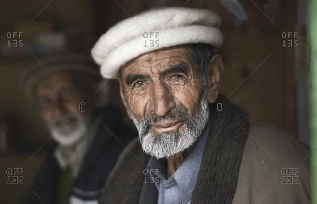 Pakistan - June 6, 2009: Pakistani men in a chai shop on the Karakorum Highway