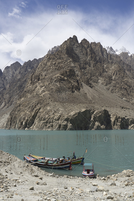 Boats docked on Lake Attabad, Upper Hunza, created by a massive landslide, Gilgit-Baltistan, Pakistan