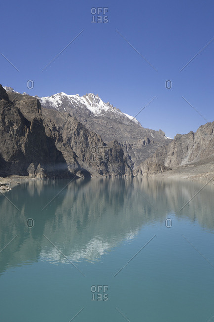 Mountain reflecting in Lake Attabad, Upper Hunza, created by a massive landslide, Gilgit-Baltistan, Pakistan