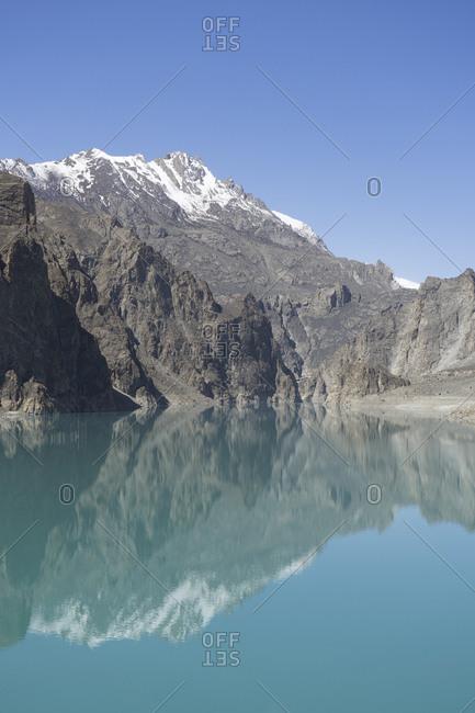 Mountain reflecting in Lake Attabad, Upper Hunza, Gilgit-Baltistan, Pakistan