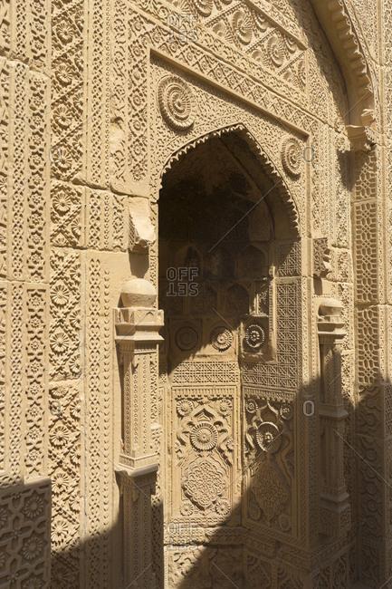 Thatta, Pakistan - April 21, 2018: Elaborately carved portal in the Makli Necropolis of Thatta, Pakistan