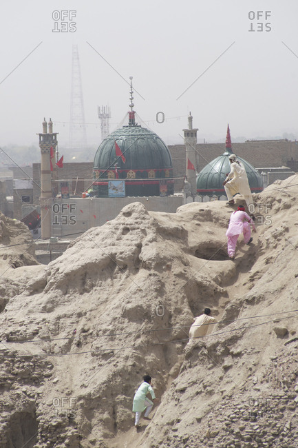 Sehwan Sharif, Pakistan - April 25, 2018: Pilgrims climb hill at the annual Urs festival