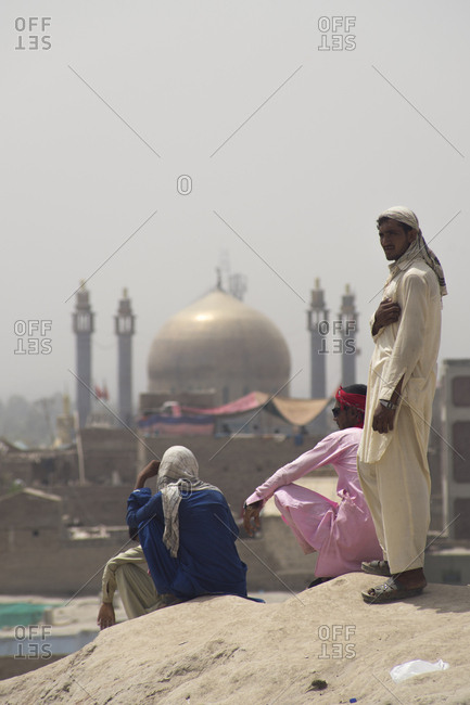 Sehwan Sharif, Pakistan - April 25, 2018: Pilgrims looking out from hilltop at the annual Urs festival