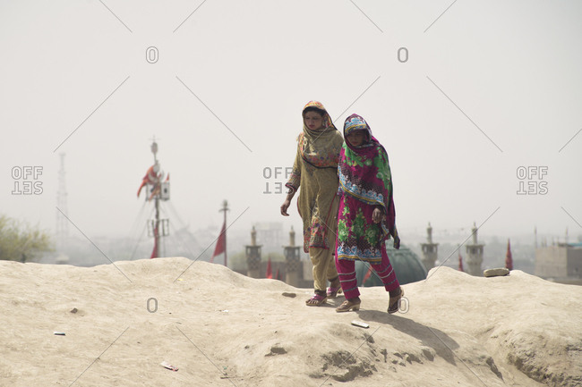 Sehwan Sharif, Pakistan - April 25, 2018: Pilgrims walking on hilltop at the annual Urs festival