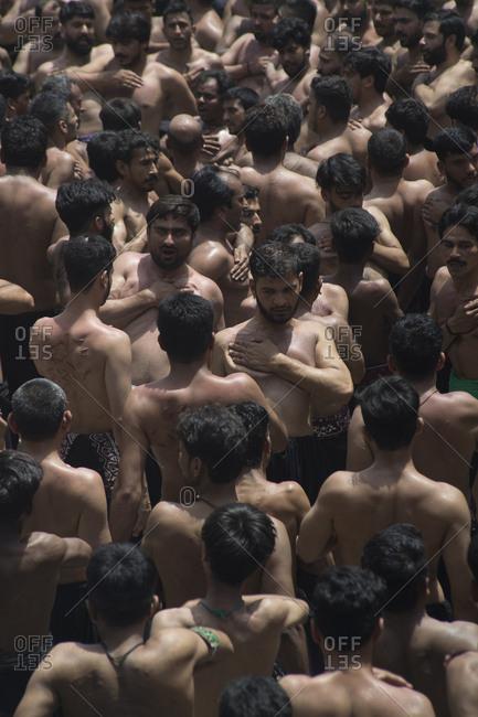Lal Shahbaz Qalandar, Sehwan Sharif, Pakistan - April 25, 2018: Group of men Shi'a Self-flagellation (madam) at annual Urs Festival