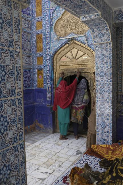 Daraza, Ranipur, Khairpur, Sindh, Pakistan - April 27, 2018: Pilgrims entering Dargah Hazrat Sachal Sarmast, Sindh
