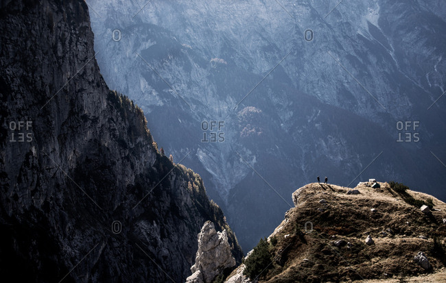 Hikers on cliff in Slovenia