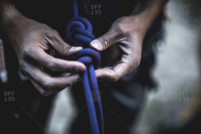 Man preparing rope for mountain climb