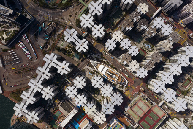 Aerial view of the Whampoa District, in Hong Kong. A yacht shaped shopping mall in the heart of a busy neighborhood.