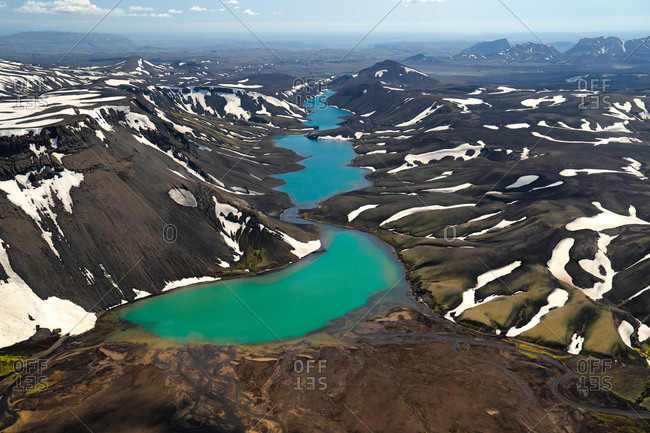 Aerial view of the Icelandic lake in landmannalaugar, Iceland. As the summer starts creeping in, the snow begins to melt in the Icelandic Highlands.