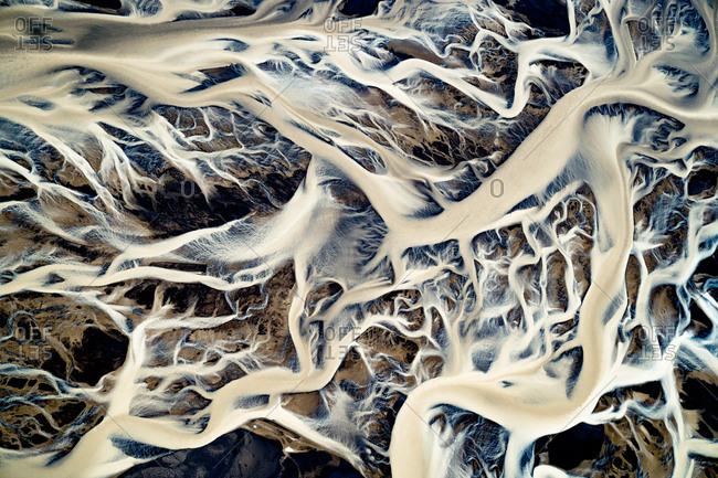 Aerial view of the Icelandic glacial rivers in Landmannalaugar, Iceland. These rivers carry sediments that have been trapped in the glacier ice for centuries and sometimes millennia.