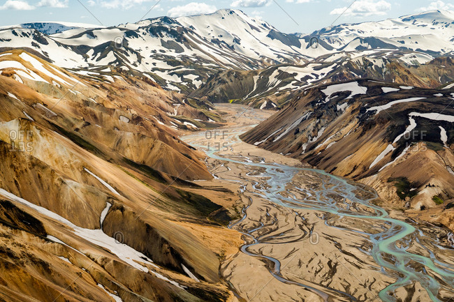 Aerial view of a glacial river flowing through the Fjallabak Nature Reserve. Located in the Icelandic Highlands of Landmannalaugar.