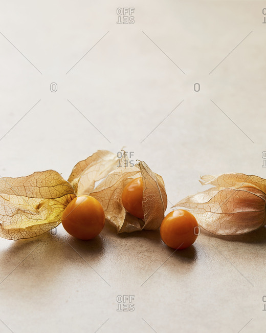 Few Cape Gooseberries on beige background