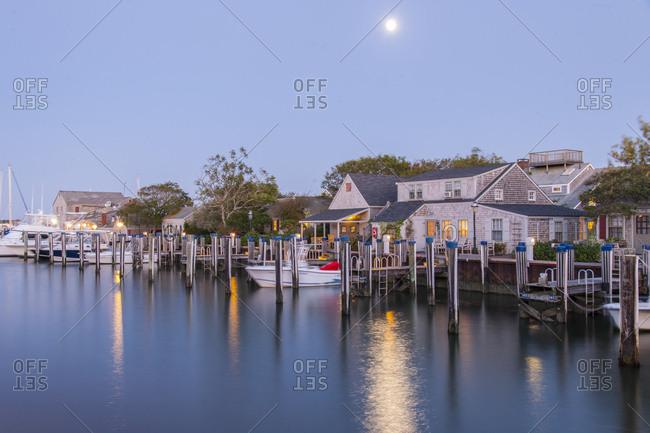 September 18, 2013: USA, Massachusetts, Nantucket Island . Straight Wharf. Houses and moored boats