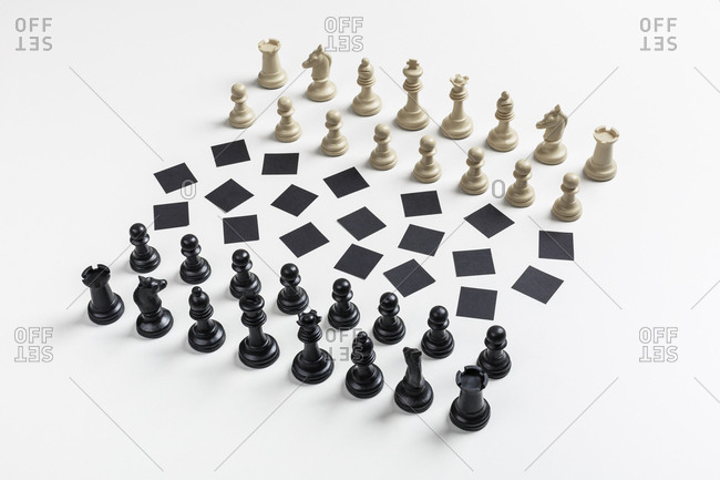 Chess figures placed in front of chaotic chess board
