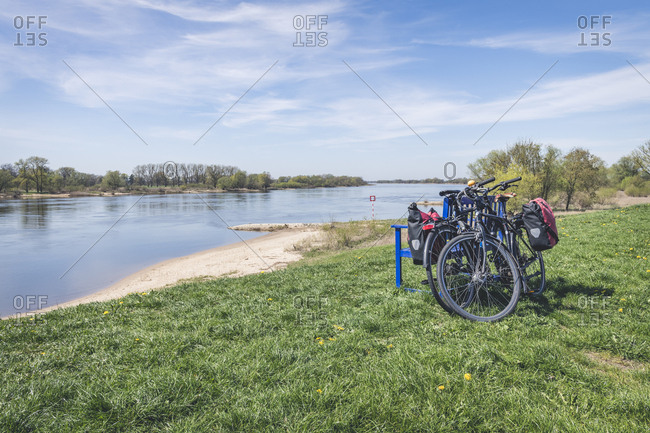 April 20, 2019: Bench with bikes at River Elbe- Viehle- Lower Saxony- Germany