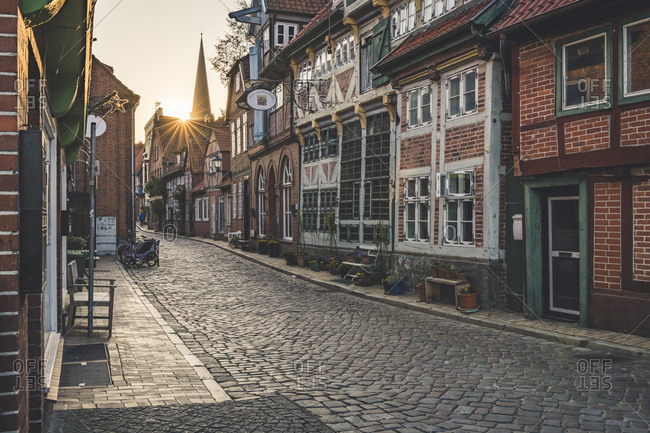 April 20, 2019: Half-timbered houses at an alley at sunset- Lauenburg- Schleswig-Holstein- Germany
