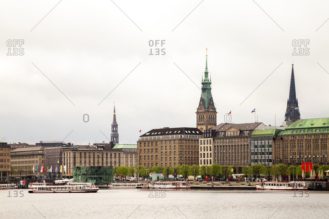 July 8, 2019: City view with city hall and St Nikolai Memorial and Inner Alster in the foreground- Hamburg- Germany