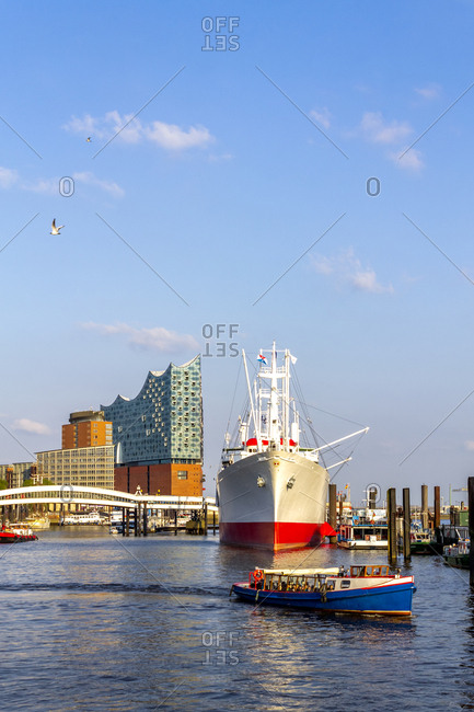 July 8, 2019: View to Elbe Philharmonic Hall with ship and boats in the foreground- Hamburg- Germany