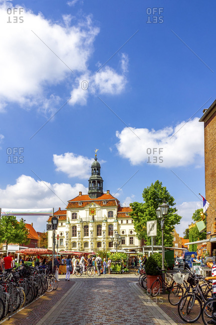 July 8, 2019: View to townhall with weekly market in the foreground- Lueneburg- Germany