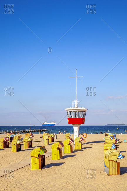 July 6, 2019: View to beach with hooded beach chairs and attendant's tower- Luebeck Travemuende- Germany