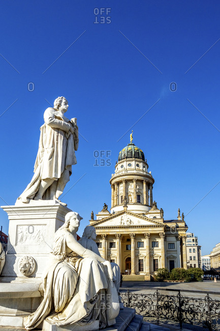 July 6, 2019: View to French Cathedral with Schiller Monument in the foreground- Gendarmenmarkt- Berlin- Germany
