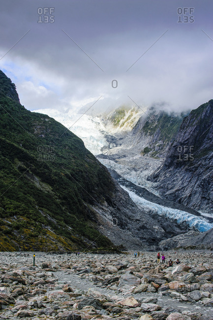 March 23, 2011: Tourists hiking up to the Franz Josef Glacier- South Island- New Zealand