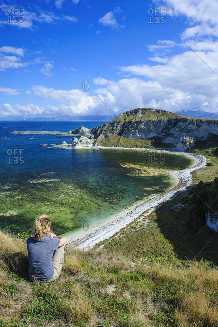 March 31, 2011: Tourist looking from the cliff top over the Kaikoura Peninsula- South island- New Zealand
