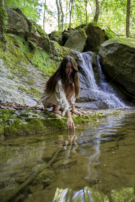 Young woman at a natural pool in forest- Garrotxa- Spain