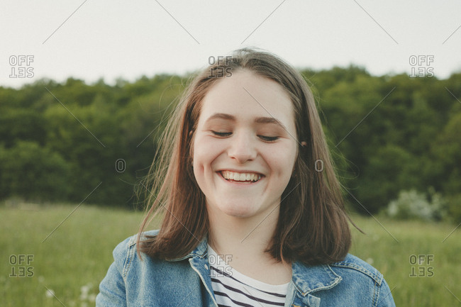 Portrait of laughing teenage girl in nature