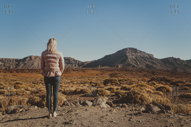 Back view of woman looking at Teide Volcano- Caldera de las Canadas- Tenerife- Spain