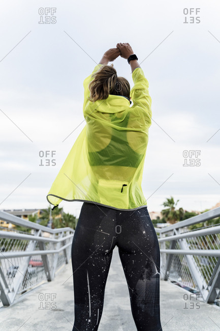 Female athlete stretching after workout