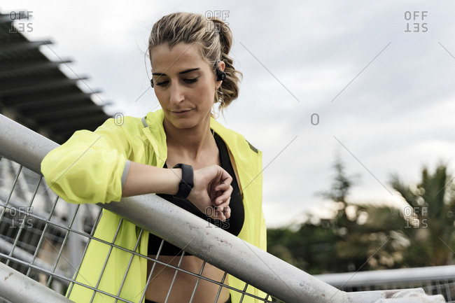 Sporty woman checking heart rate after workout