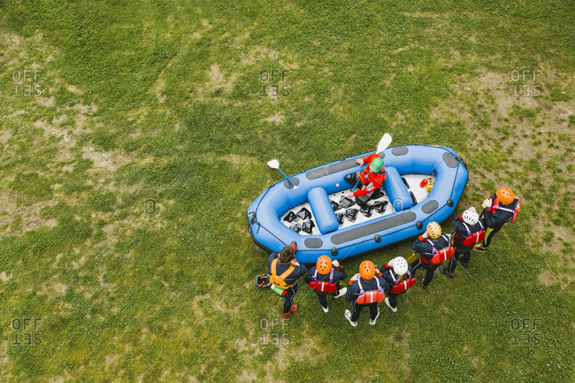 Top view of instructor talking to group of friends at a rafting class