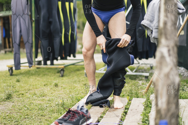 Close-up of man preparing for a boat trip putting on wetsuit