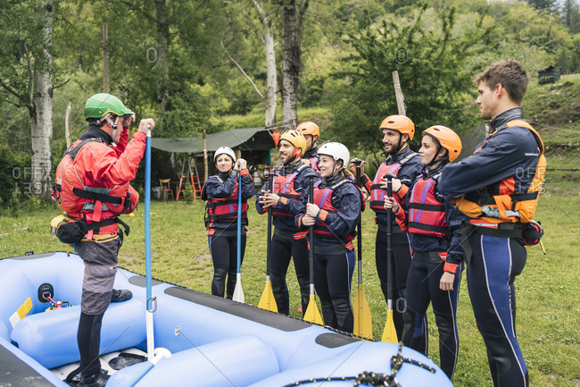 Instructor talking to group of friends at a rafting class