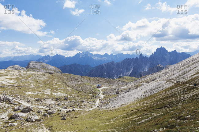 Hiking trail- hikers on trail- Tre Cime di Lavaredo Area- Nature Park Tre Cime- Unesco World Heritage Natural Site- Sexten Dolomites- Italy
