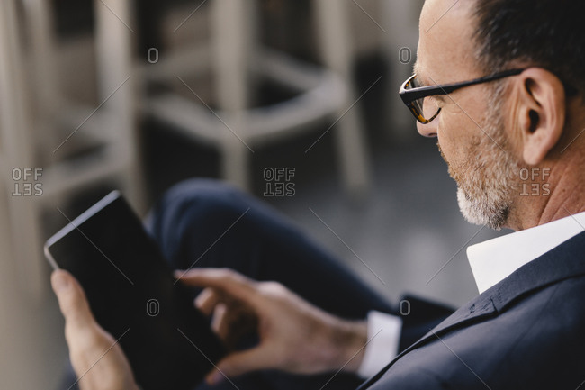 Mature businessman using tablet