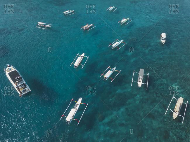Tourists boats- Crystal Bay at Nusa Penida Island- Bali- Indonesia