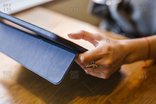 Young businesswoman using tablet in a bar