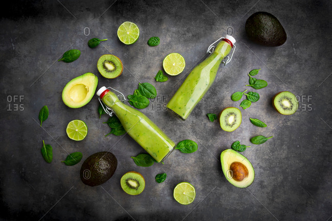 Green smoothie with avocado- spinach- kiwi and lime- coconut flakes and black sesame