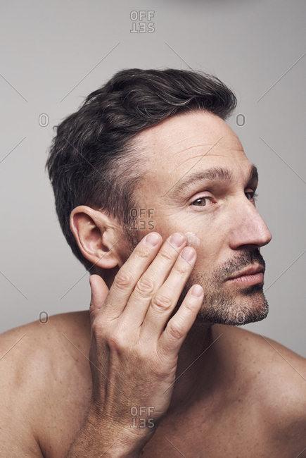 Man creaming his face