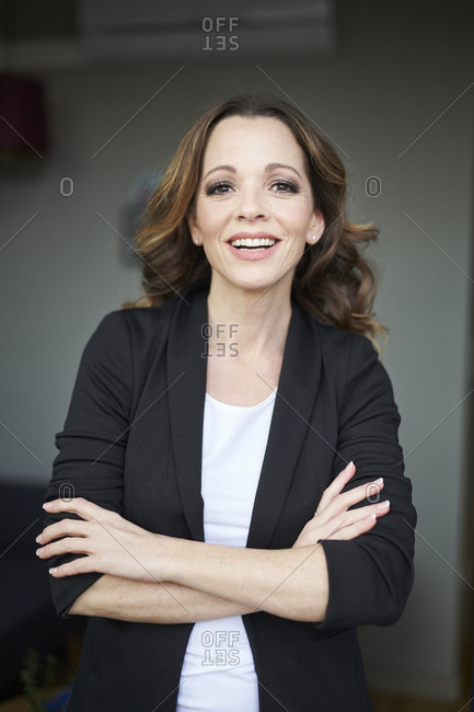 Portrait of happy businesswoman with arms crossed