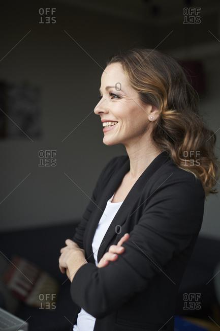 Portrait of happy brunette businesswoman looking away
