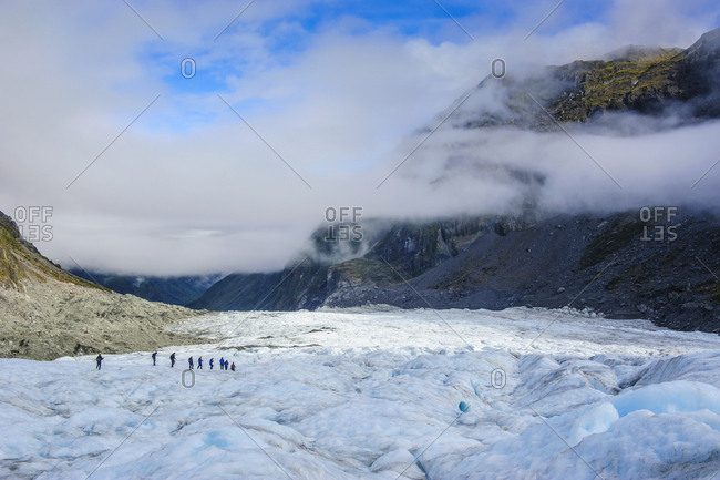 Tourists hiking on Fox Glacier- South Island- New Zealand