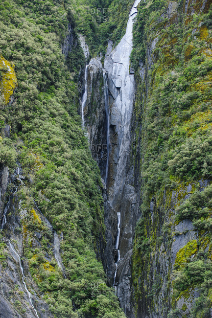 Huge waterfall on the bottom of the Franz Josef Glacier- South Island- New Zealand