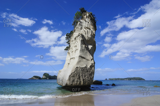 Giant rock on the sandy beach of Cathedral Cove- Coromandel- North Island- New Zealand