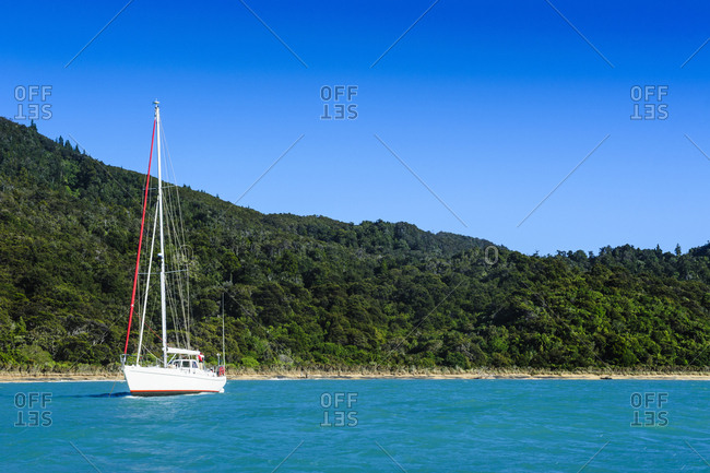 Sailing boat anchoring in the Abel Tasman National Park- South Island- New Zealand